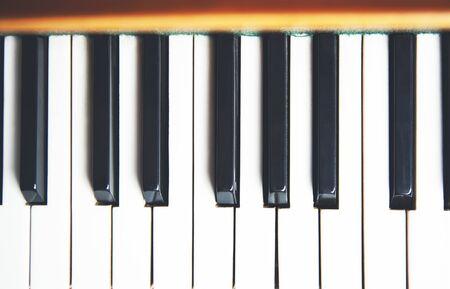 The keys of the dusty piano close Stock Photo