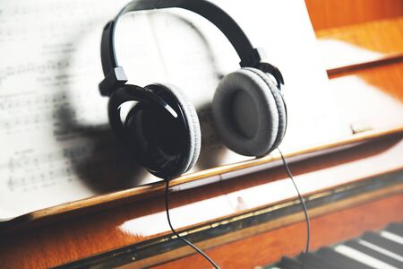 on the keyboard of the piano are headphones
