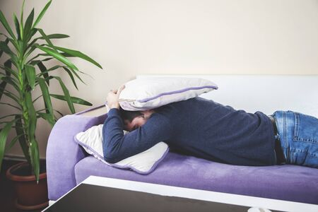 young sleeping man in sofa in home