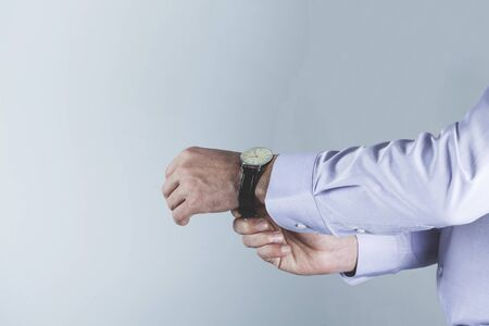 man hand watch on the gray background 免版税图像