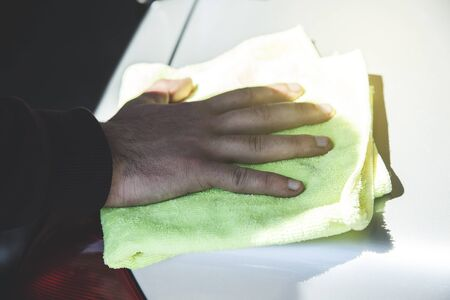 young worker man hand cloth on car
