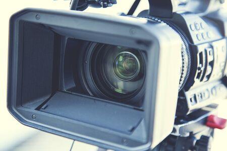 man hand holding video camera in street