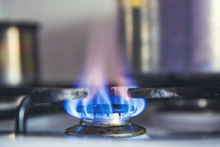 nlue burning gas in the kitchen background
