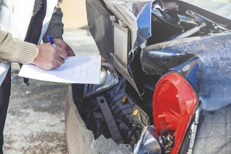 man hand document with car insurance in street Reklamní fotografie