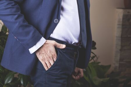 man hand on pocket in office background