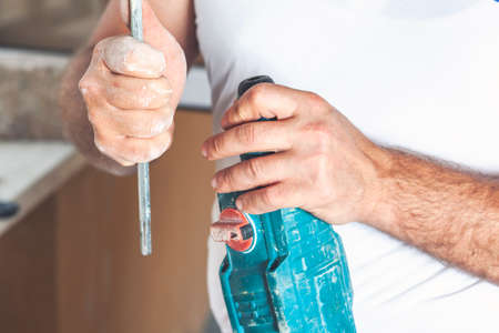 Hammer drill, installation of a chisel in a perforate.