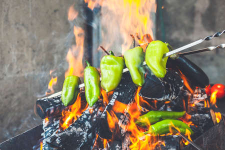 Delicious Grilled green pepper on barbecue. Vegetarian bbq