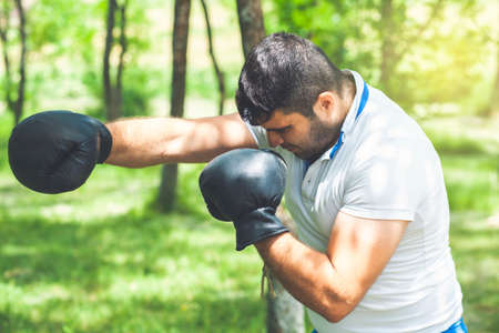 Man fighter training boxing outdoor fitness workout