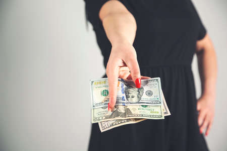 young fashion business woman hand money on gray background.