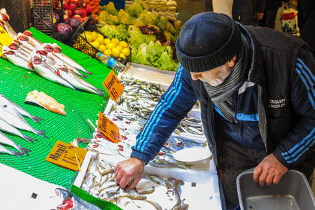 fishmonger: ISTANBUL, TURKEY - MARCH 20: Fishmonger old man on March 20, 2015 in Istanbul Editorial