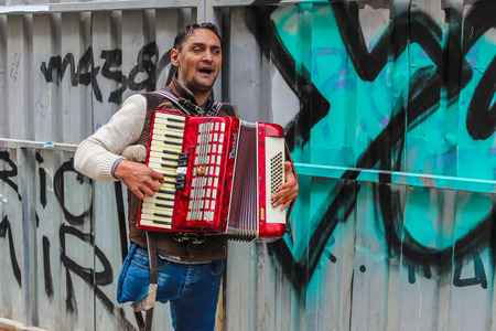 busker: ISTANBUL, TURKEY - MARCH 23: The busker playing accordion on March 23, 2015 in Istanbul Editorial