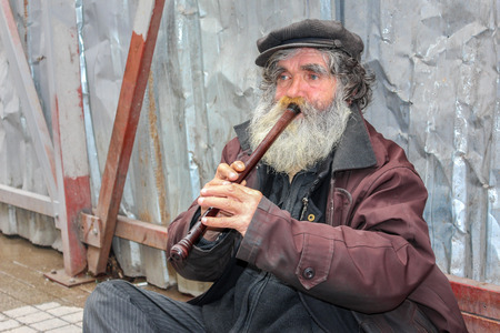 busker: ISTANBUL, TURKEY - MARCH 23: Busker playing flute on March 23, 2015 in Istanbul Editorial