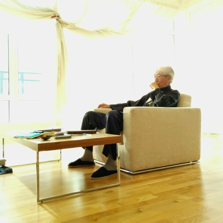 bright: An elderly man sitting in a bright room Stock Photo