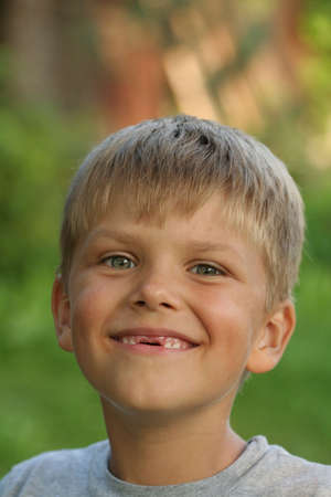 toothless: A portrait of a smiling toothless child