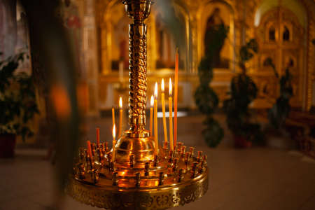 Candlestick. Candles in the church, church candle stand. Candles are burning