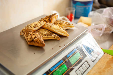 Baking with seeds, herbs on electronic scales. Natural light