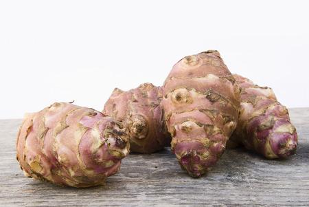 helianthus: Topinambur root  also known as Jerusalem artichoke (Helianthus tuberosus). Edible rhizome native to North America with a taste similar to the artichoke.