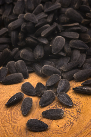 ingrediant: Close-up of sunflower seeds on wooden table