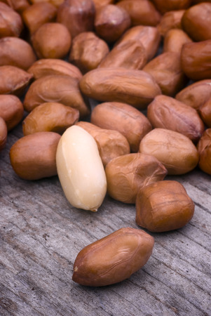 arachis: Shelled peanuts (Arachis hypogaea), legumes used for human consumption and animal feed. Stock Photo