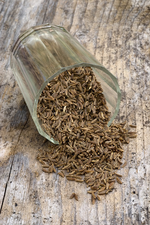 Close up of dry caraway seeds. with container glass photo