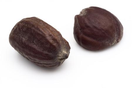 Jojoba seeds (Simmondsia chinensis) on withe beckground