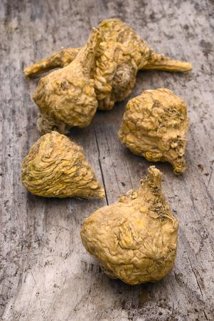 Peruvian ginseng or maca (Lepidium meyenii), dried root on wooden table Archivio Fotografico