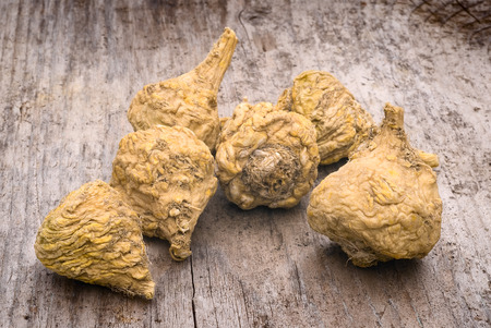plant roots: Peruvian ginseng or maca (Lepidium meyenii), dried root on wooden table Stock Photo