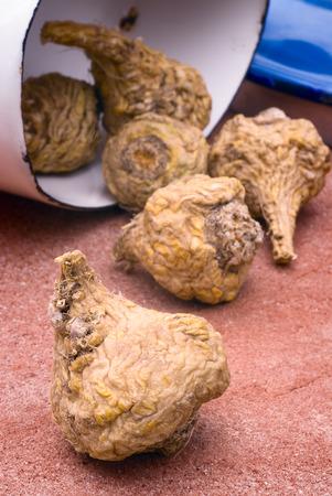 maca: Peruvian ginseng or maca (Lepidium meyenii), dried root on the table