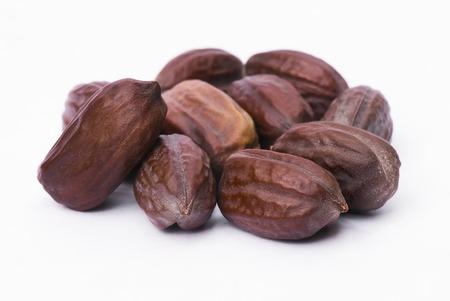 Jojoba seeds (Simmondsia chinensis) isolated on withe beckground Archivio Fotografico