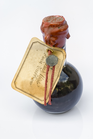 Bottle of traditional Balsamic Vinegar on a white background, product of Italian excellence