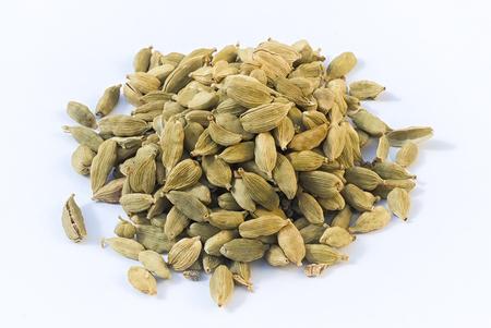 Heap of cardamom pods  (Elettaria cardamomum) isolated on white beckground Stock fotó