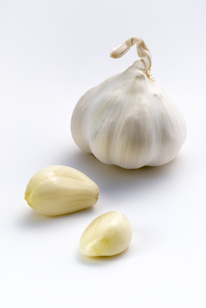 Garlic (Allium sativum) isolated on white background, clove and head Stock fotó