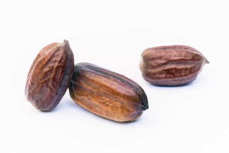 Jojoba seeds (Simmondsia chinensis) isolated on withe beckground Stock fotó
