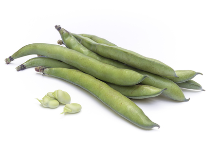 Broad beans (Vicia faba) in pods and seeds in white background Stock Photo