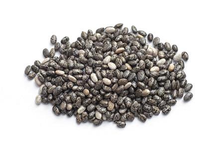 Chia seeds (Salvia hispanica) Pile of seeds on white background