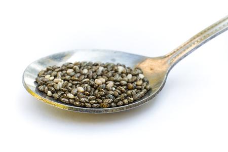 Chia seeds (Salvia hispanica) with spoon on white background