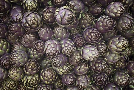 Artichokes (Cynara cardunculus), pile for background
