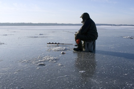 frozen lake: Winter fishing
