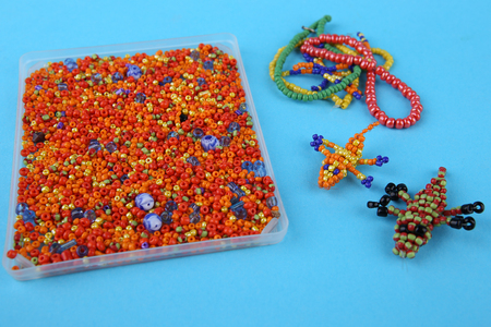 kids weaving: Beads and bead crocodiles