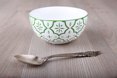 Emty decorated bowl and spoon