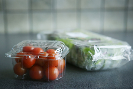 Cherry tomatoes and lettuce in plastic package