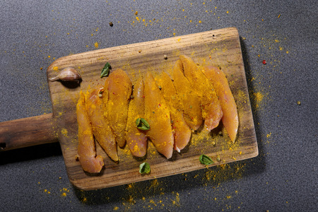 Raw chicken fillets with spices