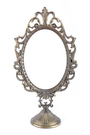 Vintage metal oval mirror on white background