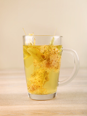 Lime tea cup with dried blossom