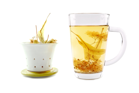 Lime tea cup with dried blossom isolated on white Stock Photo