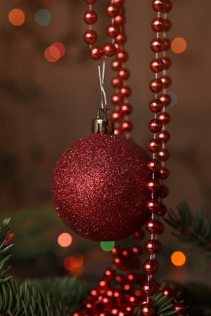 chirstmas: Red bauble and beaded garlands decor. Christmas card. Decoration on chirstmas tree. Stock Photo