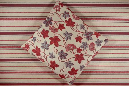 Decorative ornamental pillow. Fabric tapestry furniture.