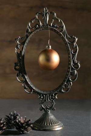 mirror frame: Vintage mirror frame and christmas ball. Subtle Christmas mood.