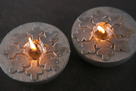 Silver  candles  with snowflakes. Winter, Christmas decoration