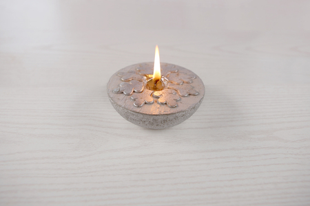 Silver  candle  with snowflake. Winter, Christmas decoration on wooden white background. Stock Photo